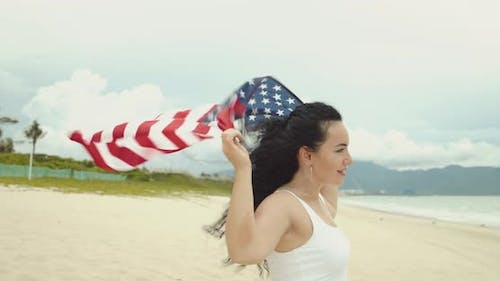 Patriotism Independence Day and Holidays Concept Happy Smiling Young Woman in Swimsuit with National