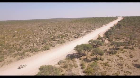 Safari Vehicle Kicking Dust