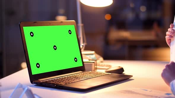 Thumbnail for Businesswoman with Green Screen on Laptop at Night 74