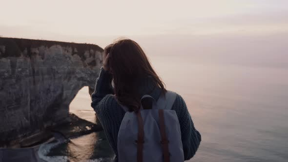 Thumbnail for Rear View Beautiful Young Female Tourist Meditating, Watching Gorgeous Sunset Sea Cliffs Panorama of