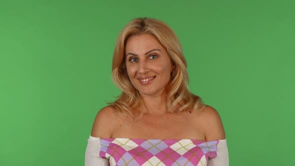 Thumbnail for Gorgeous Mature Woman Looking Surprised on Green Chromakey Background