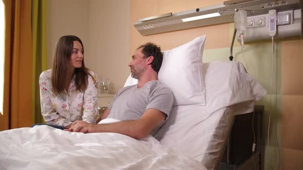 Thumbnail for Sick Husband and His Wife Talking in Hospital Ward
