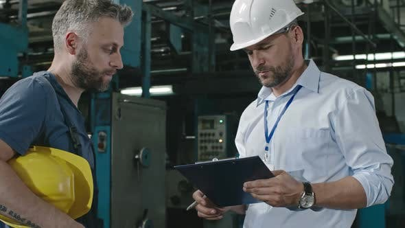 Thumbnail for Worker Shaking Hands with Factory Supervisor