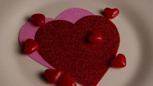Rotating stock footage shot of Valentines decorations and candies - VALENTINES 0109