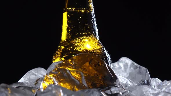 Thumbnail for Condensate Flows Down the Brown Glass of Bottle From Beer. Black Background. Close Up