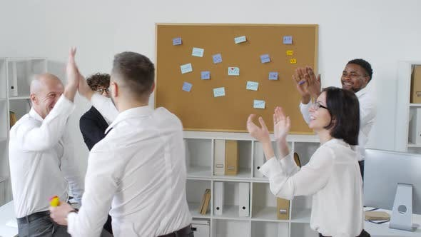 Thumbnail for Office Workers Playing Motivational Game of Darts
