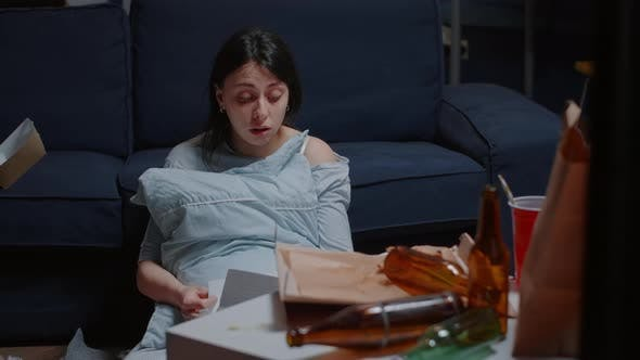 Depressed Woman Reading Eviction Notice Screaming Crying Suffering a Shock