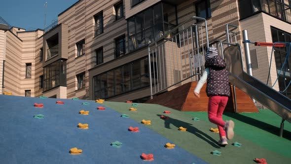 Adorable Little Girl Having Fun on Playground