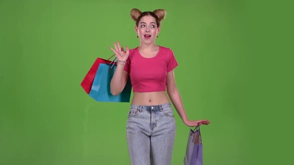 Thumbnail for Girl Goes Shopping with Bags in His Hands. Green Screen