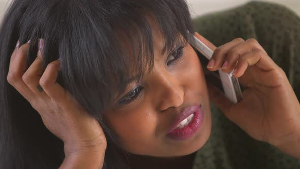 Thumbnail for African American woman talking and smiling using cellphone