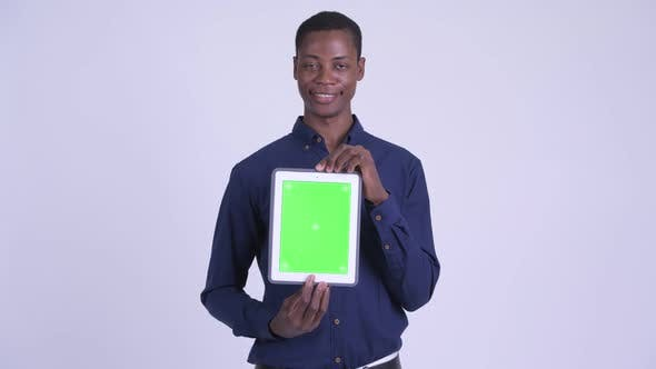 Young Happy African Businessman Showing Digital Tablet