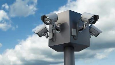 Surveillance Cctv Security Cameras Against Timelapse Skyline