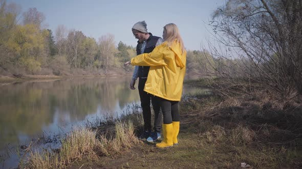 Thumbnail for Stylish Couple Looking at the River in the Forest