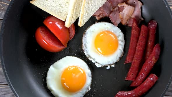 Fried Eggs, Sausages and Tomato