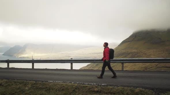 Thumbnail for Hiker Walking Along Road On Vidareidi