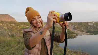 Happy Woman Taking Photos on Hike