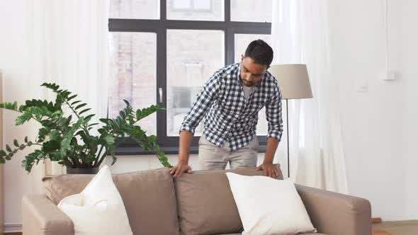 Thumbnail for Indian Man Arranging Sofa Cushions at Home 44