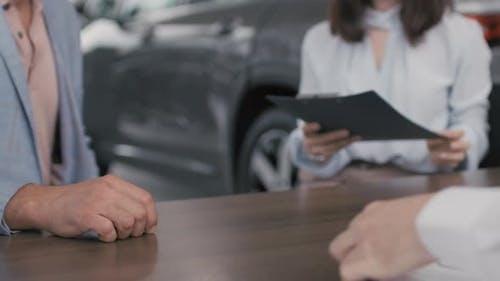People Closing Deal in Dealership