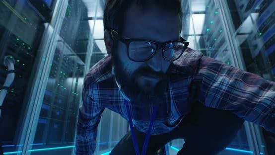 Thumbnail for Grimacing IT Engineer in Server Room