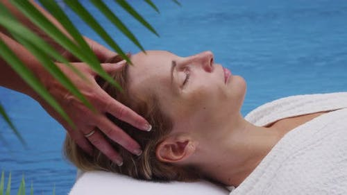 Woman at spa laying by pool. Shot on RED EPIC for high quality 4K, UHD, Ultra HD resolution.