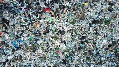 A landfill filled with trash which is not recycled.