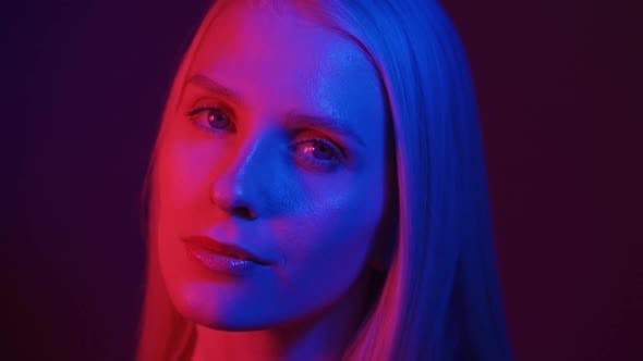 Portrait of a Young Woman Model in Neon Light