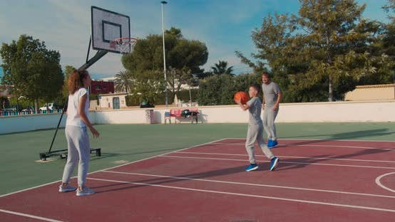 Thumbnail for Family Playing Basketball on Outdoor Court