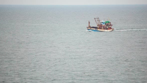 Thumbnail for Fishing boat floats on the tropical sea on a cloudy day