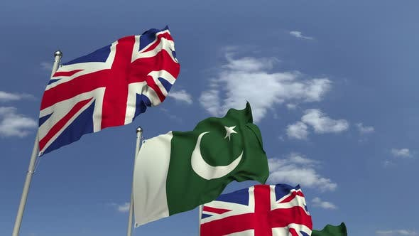 Waving Flags of Pakistan and the United Kingdom