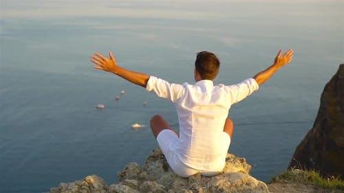 Man Outdoor on Edge of Cliff Seashore
