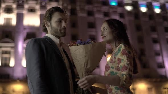 Thumbnail for A Guy Gives Flowers To a Girl on a Date. Slow Motion