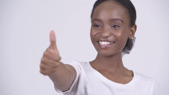 Thumbnail for Face of Young Happy African Woman Smiling and Giving Thumbs Up