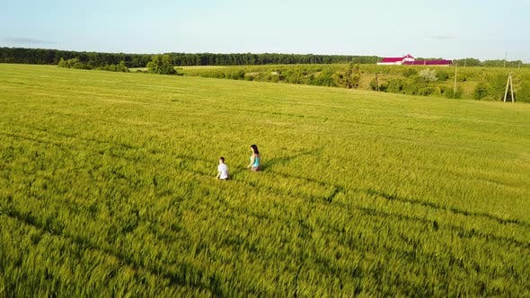 Thumbnail for Family Walking Around Field
