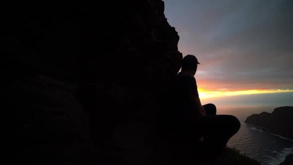 Thumbnail for Man Watching Sunrise From Mountains