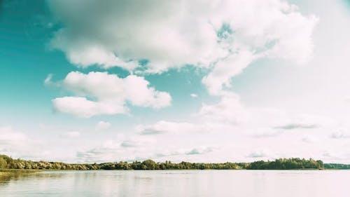 Lyepyel District, Vitebsk Province, Belarus. Summer Cloudy Sky Above Lepel Lake. Time Lapse. ,