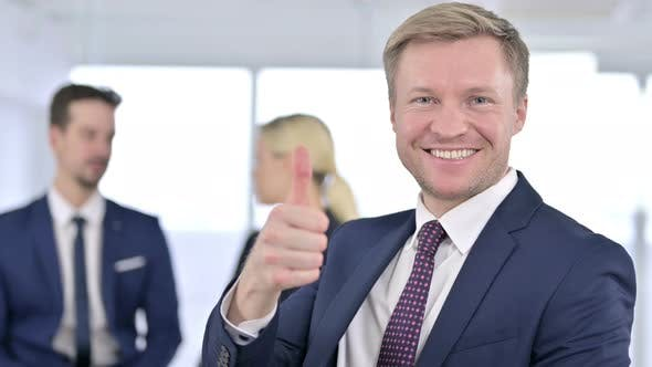 Thumbnail for Portrait of Cheerful Businessman Showing Thumbs Up in Office