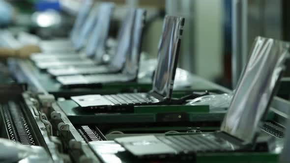 Production Line in Laptop Factory. 4K Resolution.