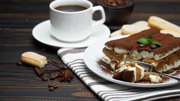 Thumbnail for Portion of Classic Tiramisu Dessert and Savoiardi Cookies on Wooden Background
