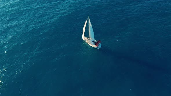 Thumbnail for Aerial View. Yacht Sailing on Opened Sea. Yachting with Sails Up at Windy Day.