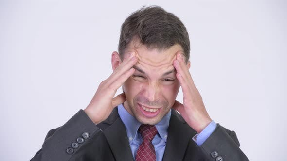 Thumbnail for Studio Shot of Stressed Businessman Having Headache