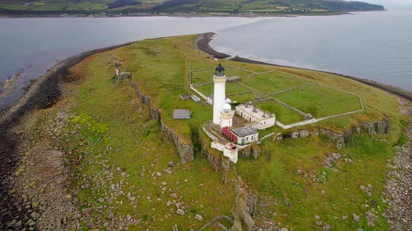 The Island of Pladda off the South Coast of Arran in Scotland with a Lighthouse
