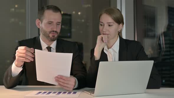 Thumbnail for Business People Reading Documents Report at Night