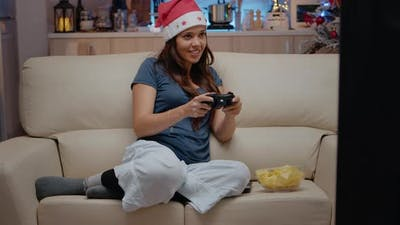 Woman Playing Video Games on Console with Controller