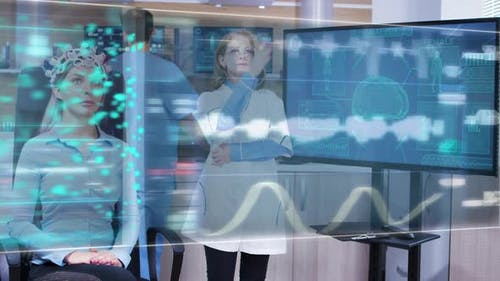 Female Scietist Looking at Virtual Hologram Interface in Front of Her Eyes