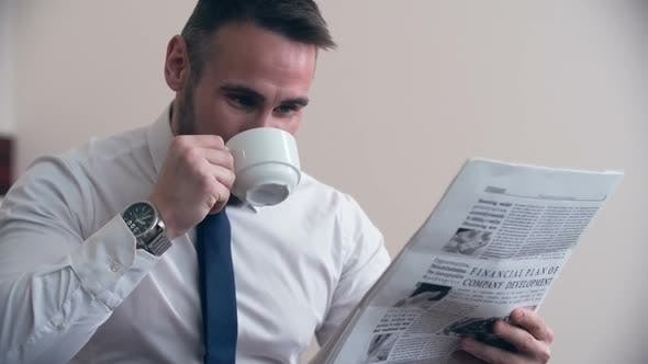 Thumbnail for Businessman Enjoying Newspaper in Hotel Room