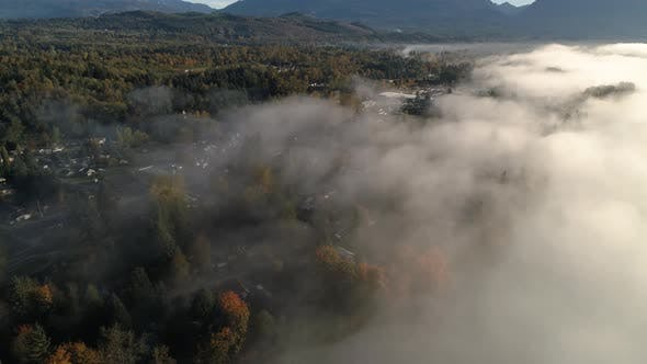 Cover Image for High Angle Panning Rural Town With Low Fog In Fall Season