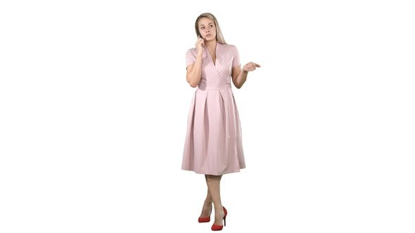 Thumbnail for Beautiful woman in pink speaking over phone