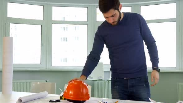 Architect Puts Hard Hat on the Desk