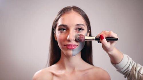 Make Up Artist Applying Clay Mask on Girl