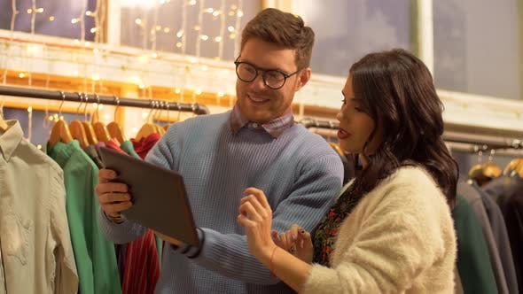 Thumbnail for Couple with Tablet Pc at Vintage Clothing Store 20